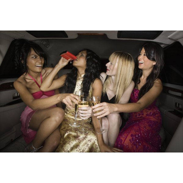 Young women drinking in an limousine.