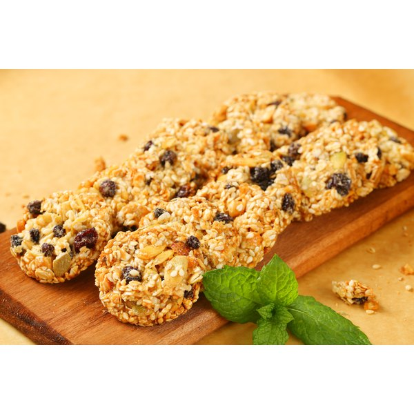 Rolled oat cookies on a chopping board.
