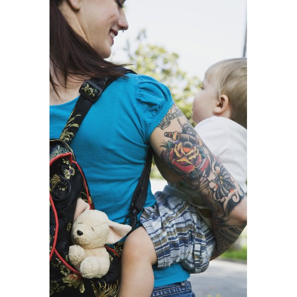 alternative and modern young mom holding her son image from behind