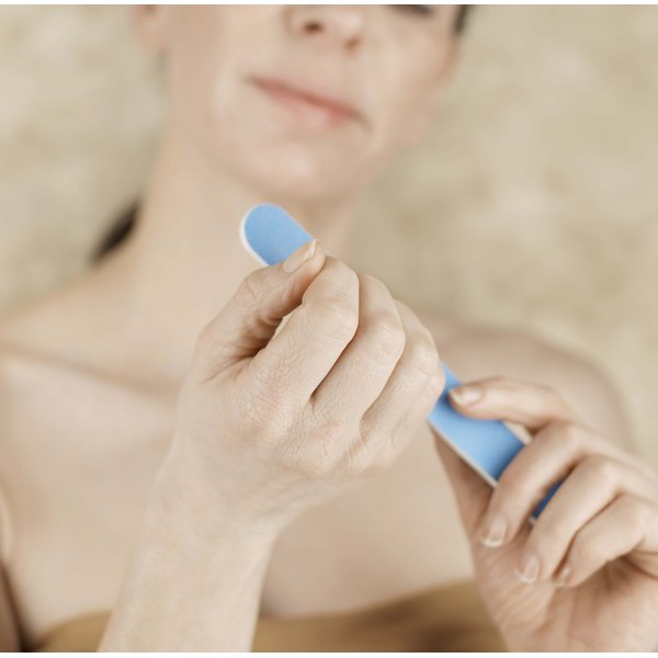Use a nail file to shape your acrylic nails.