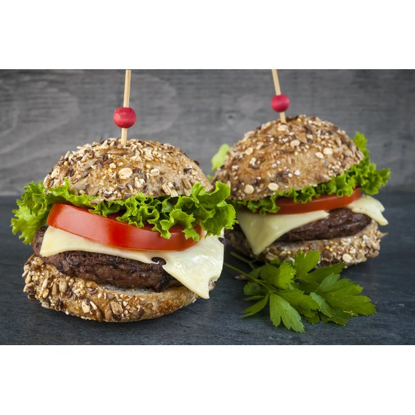 Two hamburgers with multigrain buns.