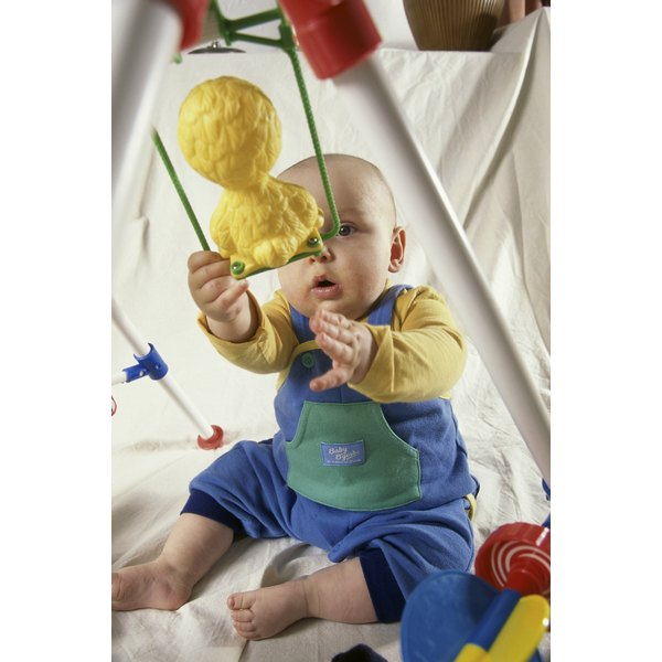 Reaching for toys helps babies strengthen arm muscles.