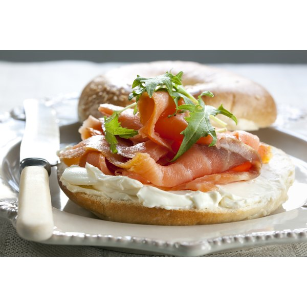 Lox and cream cheese on a whole wheat bagel.