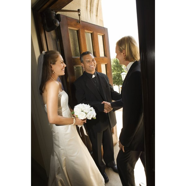 Thank your priest for helping you plan a simple Catholic Wedding.