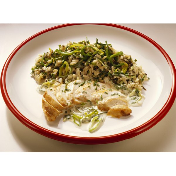 Serve baked chicken tenders with vegetable rice for a healthy meal.