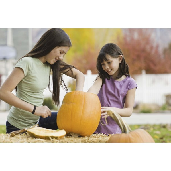 Teens can help younger siblings celebrate Halloween.