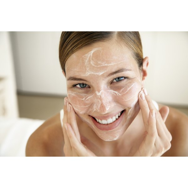 woman gently applying facial product