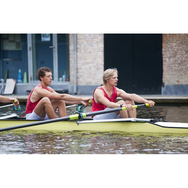 A crew team rowing in a canal.