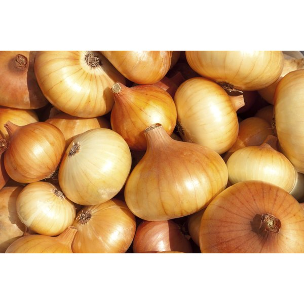 Onion juice and vinegar may help get rid of age spots.