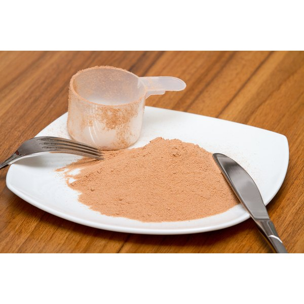 A scoop and protein powder on a plate.