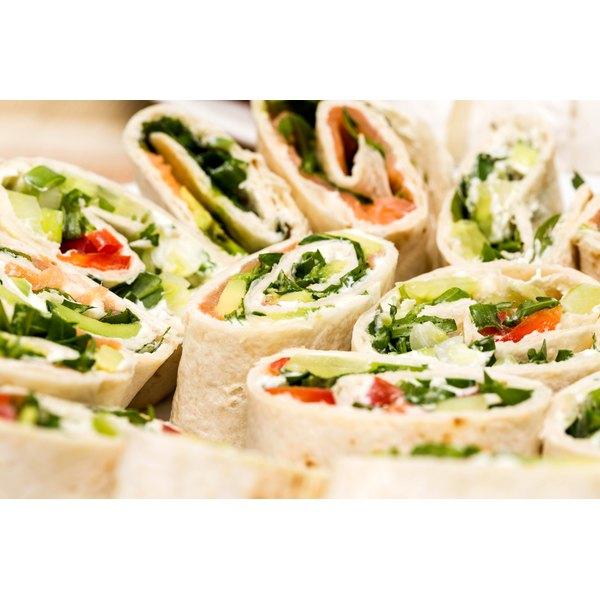A platter of sandwich wraps.