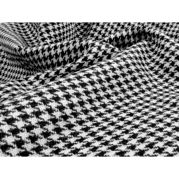 A close-up of black and white houndstooth fabric.