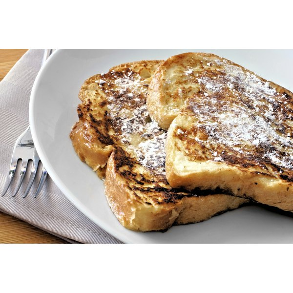 Two pieces of french toast on a large plate.