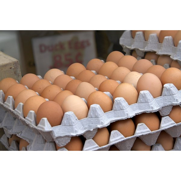 Crates of brown eggs at the farmers market.