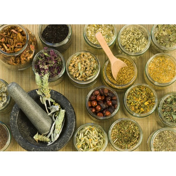 A birds-eye view of medicinal herbs in bowls.