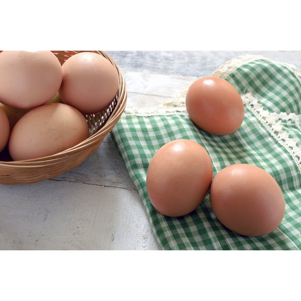 Brown eggs on a tea towel in the kitchen.