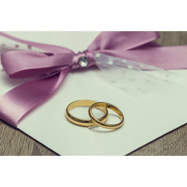 Wedding invitations and wedding rings.