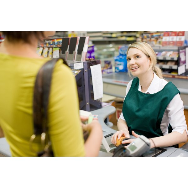 Cashier at supermarket check out.