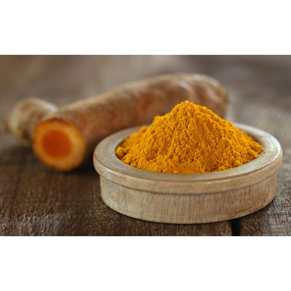 Ground tumeric in a bowl.