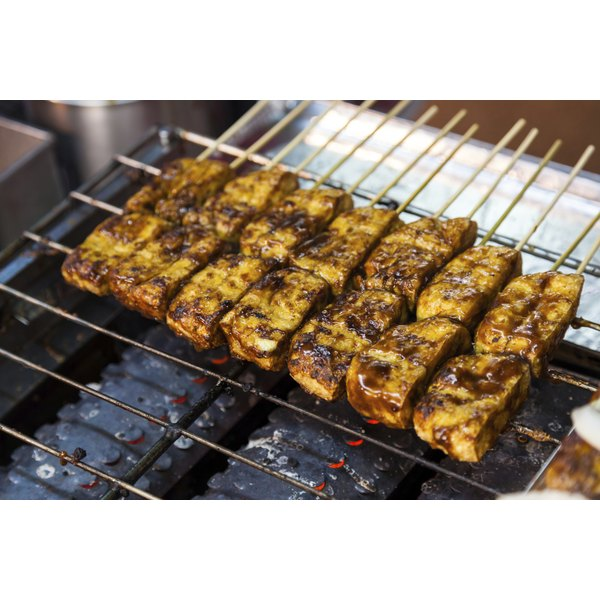 Barbecued stinky tofu on a grill.