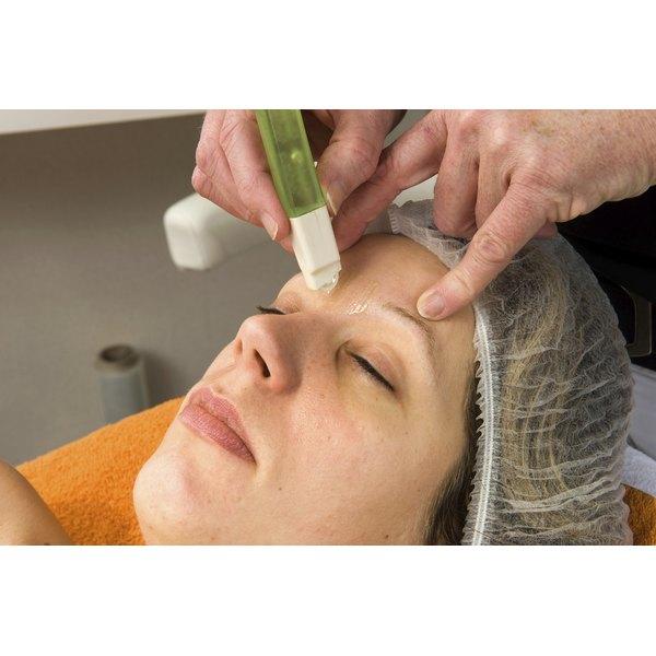 A client receiving an eyebrow wax in a salon.