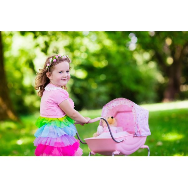 Wearing pink and playing with dolls are coded as feminine behavior in the United States.
