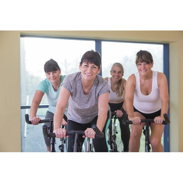 Women riding exercise bikes.