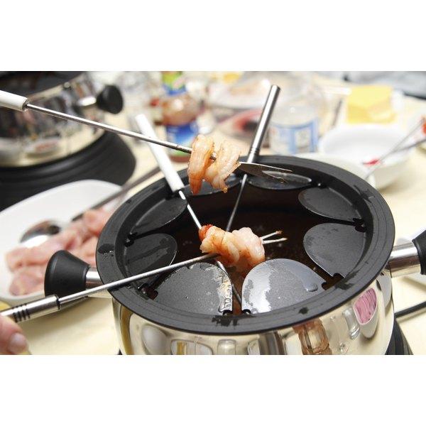 Shrimp on fondue sticks.
