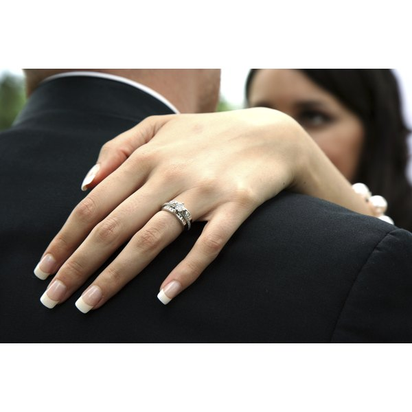 The wedding ring set is usually worn on the left hand.