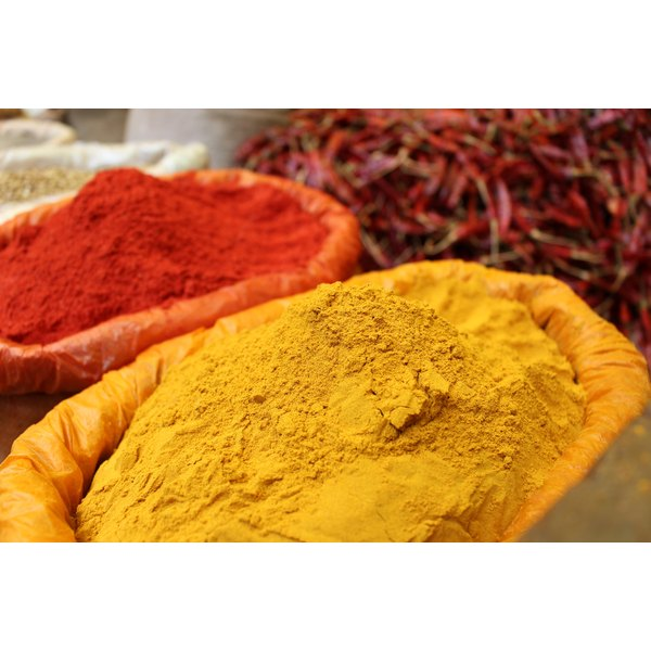 A sack of gold turmeric powder at a spice market.