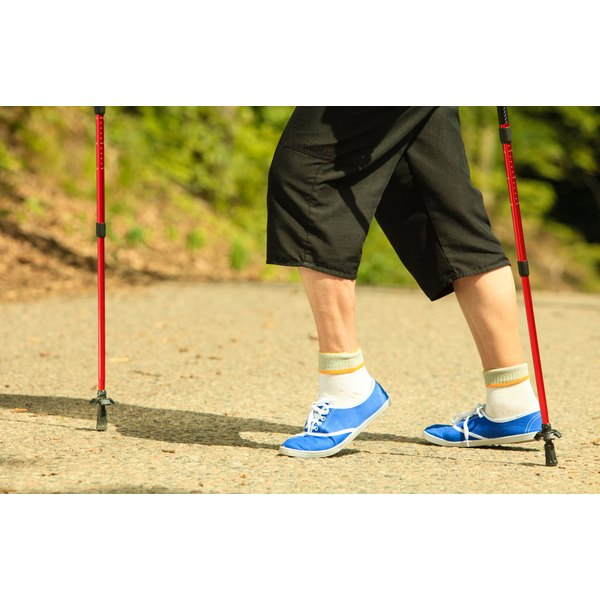 Active senior walking with nordic poles