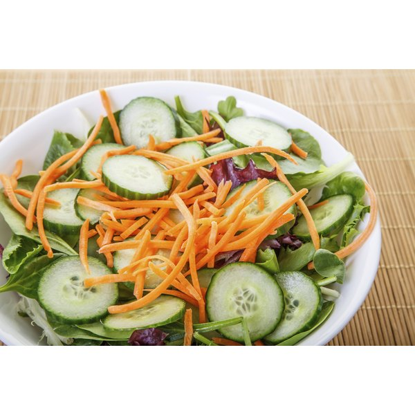 small salad with cucumbers and sliced carrots