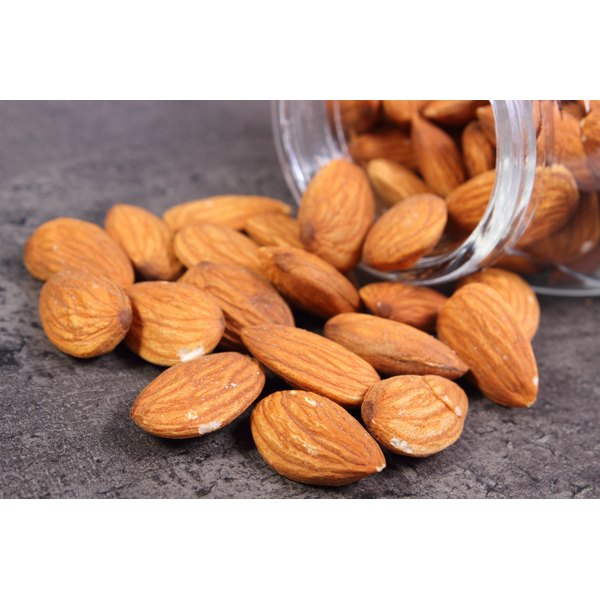 A spilled over jar of almonds, a good magnesium source.
