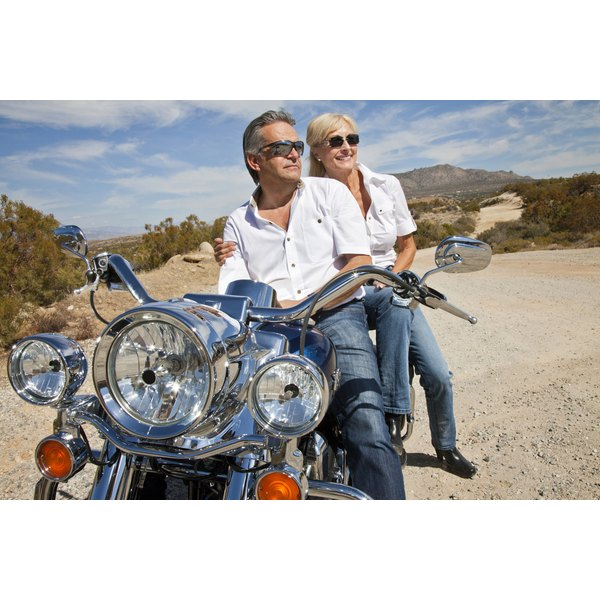 Couple sitting together on motorcycle
