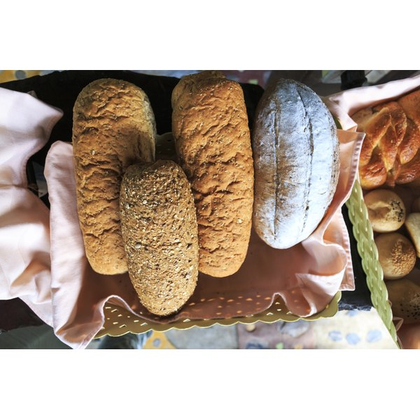An assortment of breads in a basket.
