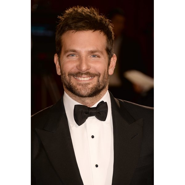 Many men — such as actor Bradley Cooper — have large foreheads, whether it's part of their natural face shape or thanks to a receding hairline.
