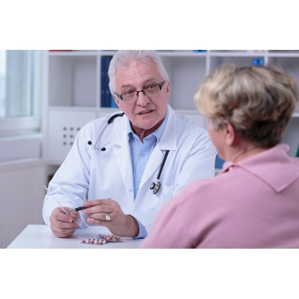 Doctor prescribing blood thinning medication to patient.