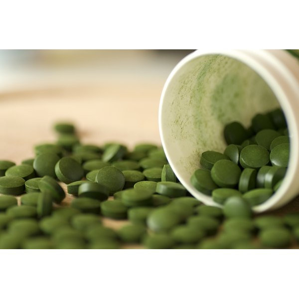 Spirulina tablets spilling from bottle