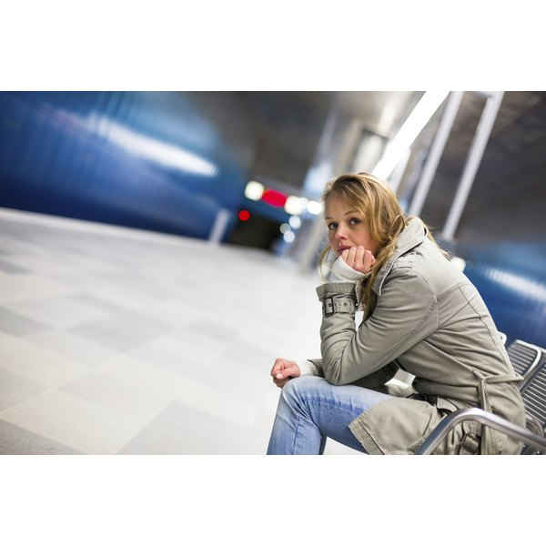 A depressed young woman in a train station.