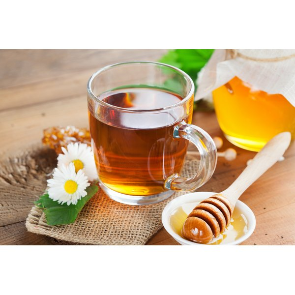 A cup of chamomile tea with honey.