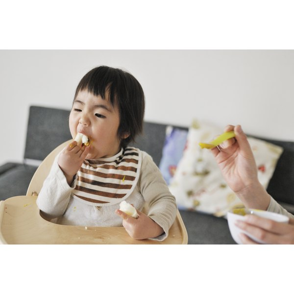 A young child is eating.