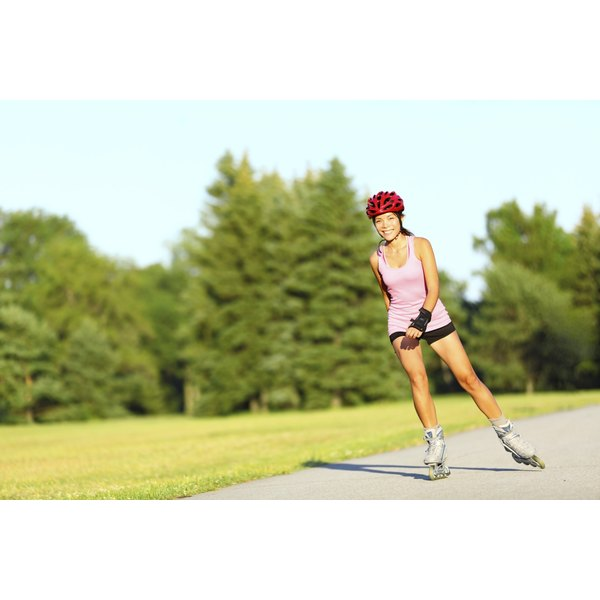 Woman rollerblading on path