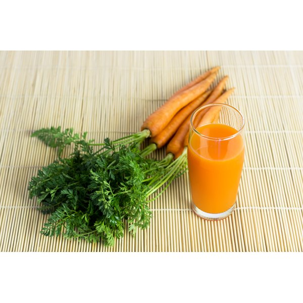 A tall glass of carrot juice.