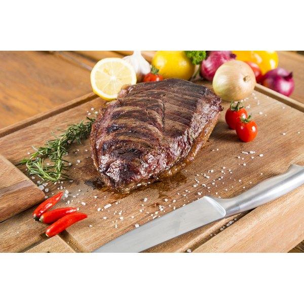 Pork roast on a chopping board.
