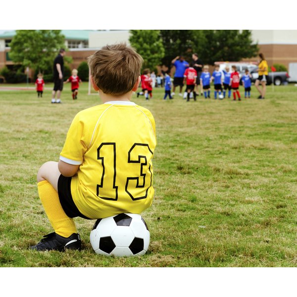 Organized sports can boost a shy child's self-esteem and foster positive relationships with adults.