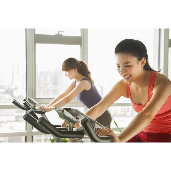 Young women exercising on stationary bikes