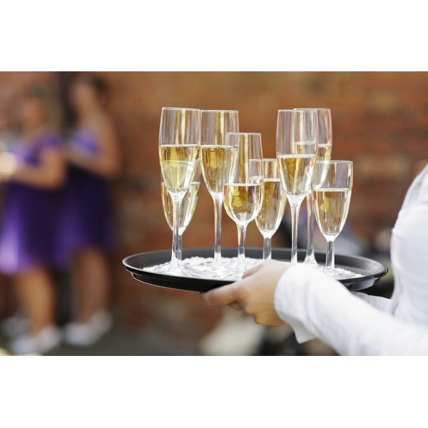 Waitress Carrying A Tray Of Champagne Gles At Wedding