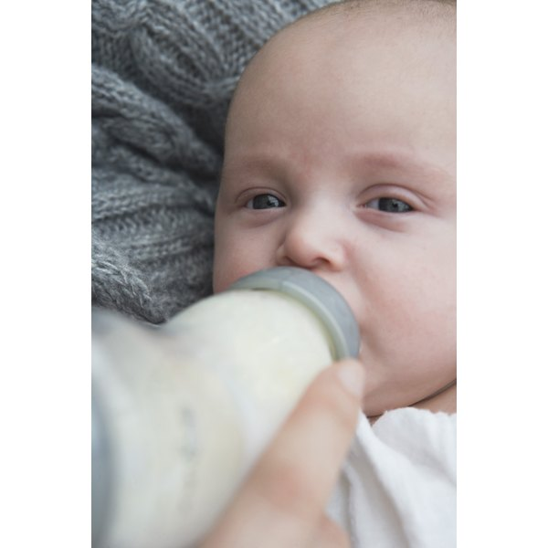 Baby drinking a bottle.