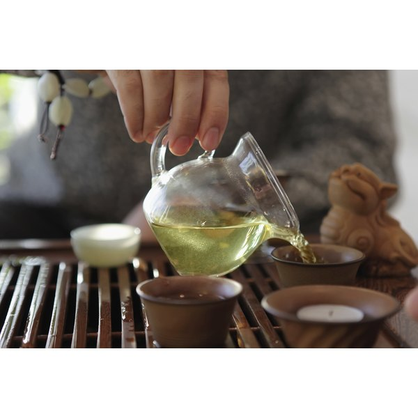 Green tea is poured during a traditional Chinese tea ceremony.