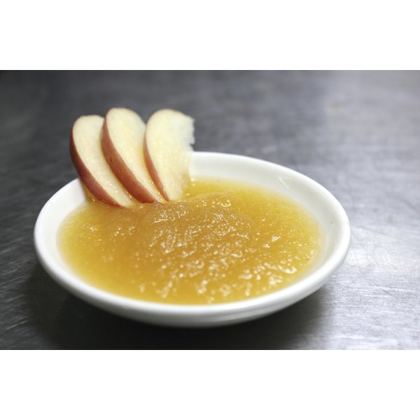 A dish of applesauce on a cafe table.